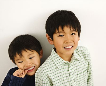 Two young Asian brothers portrait. photo