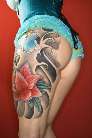 woman's: Close-up of womans tattooed leg.