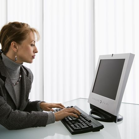 woman typing: Caucasian woman typing on computer keyboard.
