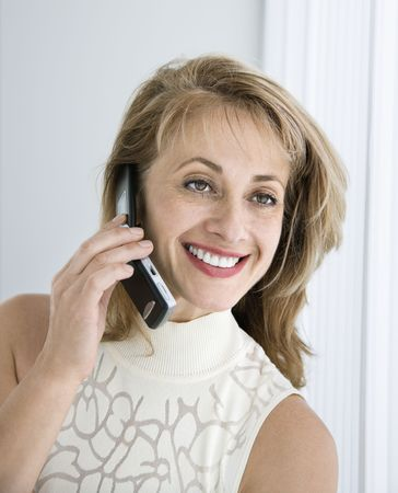 Caucasian woman smiling on cellphone. photo