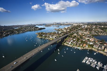 aerial photograph: Aerial view of Victoria Road bridge and boats in Sydney, Australia.