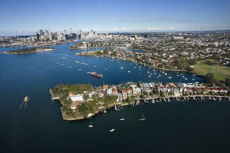 Aerial view of boats in Snails Bay with view of downtown skyline in Sydney, Australia.