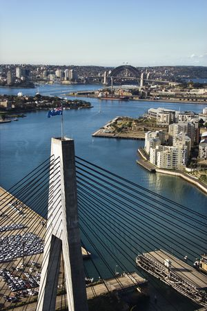 Aerial view of Anzac Bridge and buildings by harbour in Sydney, Australia. Stock Photo - 2654748