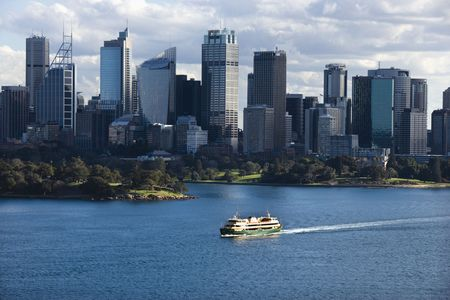 ferryboat: Aerial view ferryboat crossing harbour with skyline of  Sydney, Australia. Stock Photo