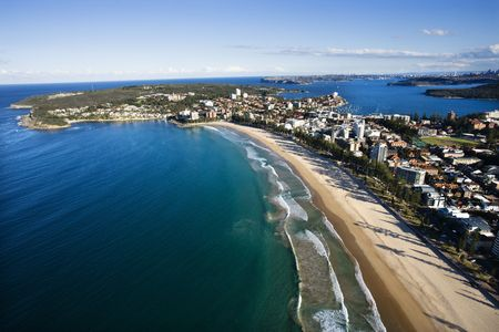manly: Aerial view of beachfront buildings and ocean in Sydney, Australia.