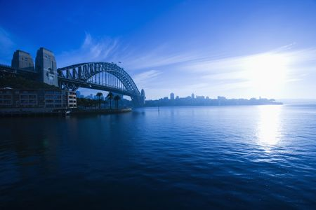 View of Sydney Harbour with Sydney Harbour bridge and distant skyline at dusk in Sydney, Australia. Stock Photo - 2654523