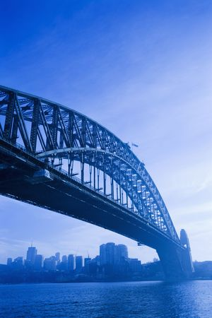 port jackson: Low angle view of Sydney Harbour Bridge in Australia with view of harbour and downtown skyline. Stock Photo