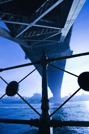View from underneath Sydney Harbour Bridge in Australia at dusk with harbor and city skyline visible. Stock Photo - 2654563