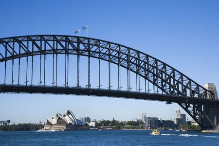 port jackson: Sydney Harbour Bridge with view of downtown buildings and Sydney Opera House in Australia. Stock Photo