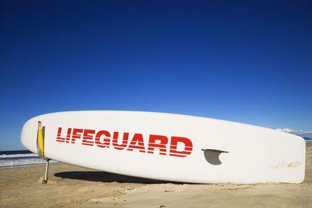 surfers paradise: Lifegaurd surfboard on beach in Surfers Paradise, Australia.