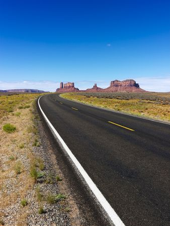 Scenic desert road with mountain land formations. photo