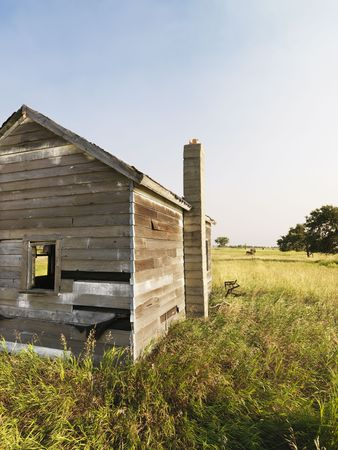 disrepair: Abandoned rural wooden house in state of disrepair. Stock Photo