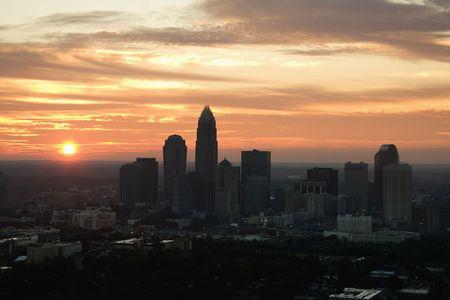 Aerial view of sunset behind city skyline of Charlotte, North Carolina. photo