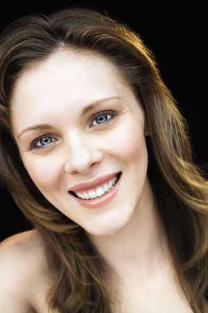 Close up portrait of young adult caucasian female smiling. photo