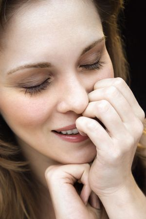 Close up portrait of young adult caucasian female with hand on face. photo