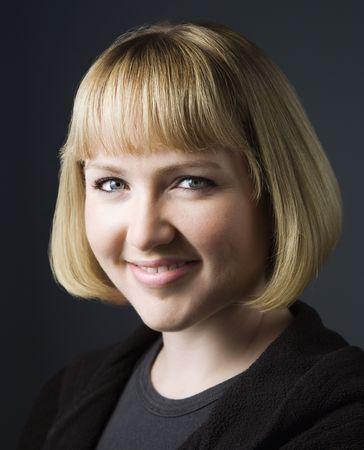 Portrait of young caucasian woman smiling. photo