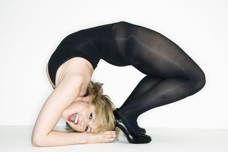 Portrait of young caucasian woman bending over backwards. photo