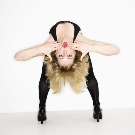 bend over: Portrait of young caucasian woman bending over backwards.
