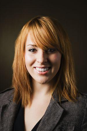 Studio portrait of pretty young redheaded female. photo