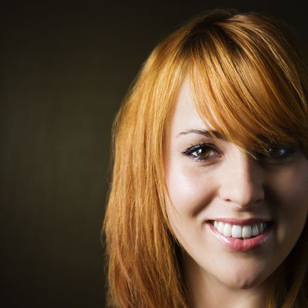 redheaded: Close-up studio portrait of pretty young redheaded female. Stock Photo