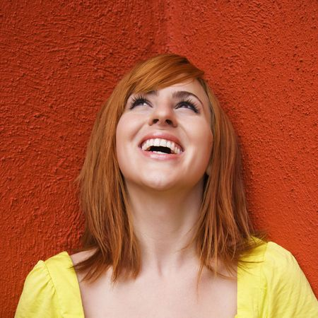 Portrait of smiling and laughing redhead looking up. Stock Photo - 3548422