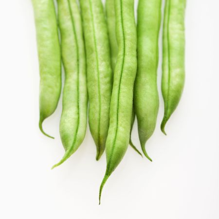 green bean: Close up of green beans on white background. Stock Photo