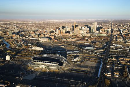 mile: Aerial cityscape of urban Denver, Colorado, with Mile High stadium in foreground.