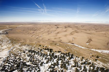great plains: Aerial landscape of snowy plains and dunes in Great Sand Dunes National Park, Colorado.