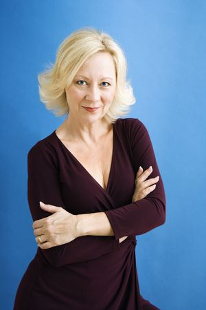 blonde close up: Studio portrait of attractive adult businesswoman looking at viewer.