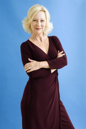 Studio portrait of attractive adult businesswoman looking at viewer. photo