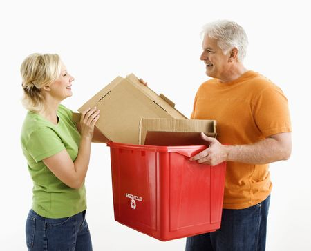 Man holding recycling bin while woman places cardboard into it. Stock Photo - 3557462