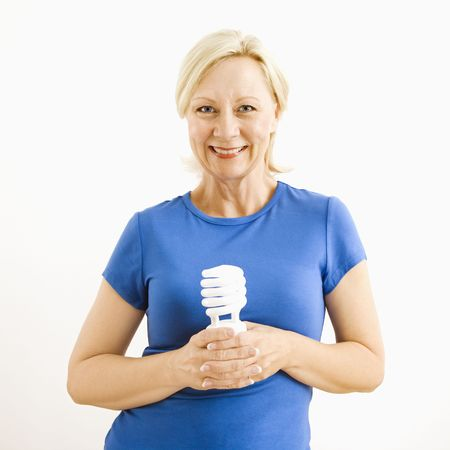 Portrait of smiling adult blonde woman holding energy-saving lightbulb. Stock Photo - 3557406