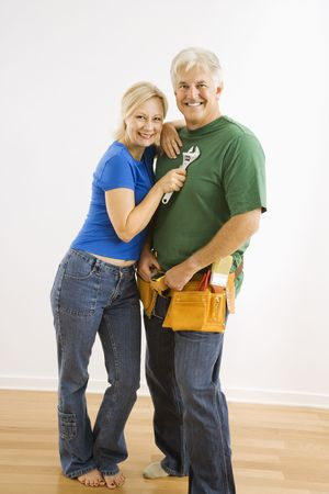 Middle-aged couple with household tools. photo
