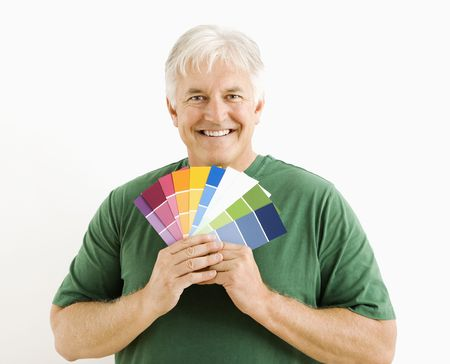 Middle-aged man holding up paint swatches. Stock Photo - 3557411