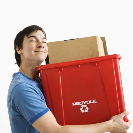 Portrait of smiling Asian young man holding recycling bin. Stock Photo - 3557431