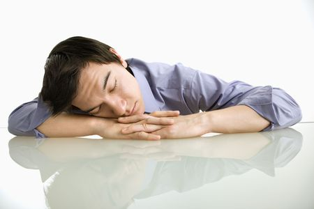 Asian businessman sleeping on desk in the office. photo
