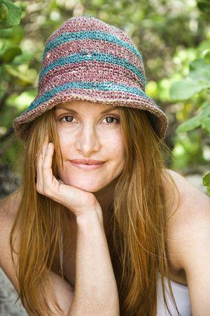 Portrait of pretty redheaded woman wearing hat. photo