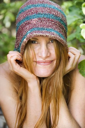 Portrait of pretty caucasian redhead wearing hat. Stock Photo - 3569583