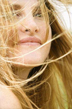 Close up portrait of attractive redheaded woman with windblown hair. photo