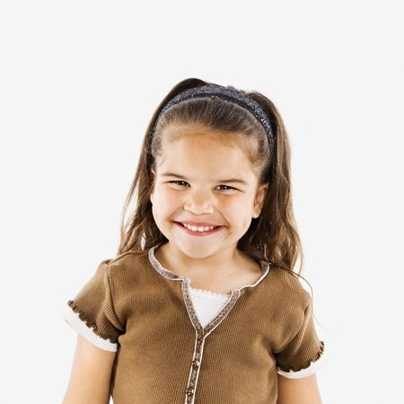 Cute little hispanic girl standing smiling. Stock Photo - 3569552
