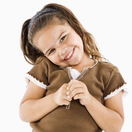 Cute little hispanic girl standing smiling at viewer. Stock Photo - 3569565