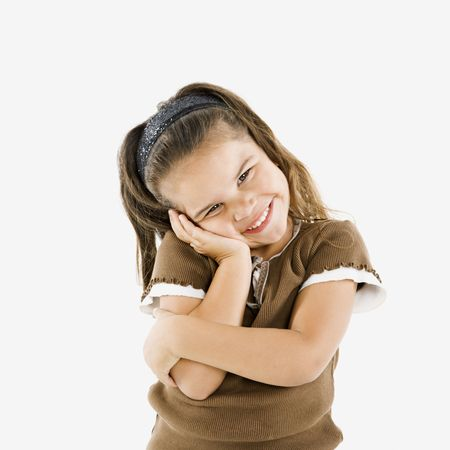Adorable little hispanic girl standing smiling with cheek in hand. Stock Photo - 3569490