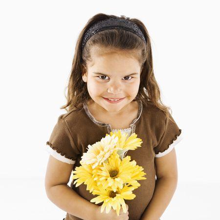 Lttle hispanic girl holding bouquet of yellow flowers. Stock Photo - 3569543