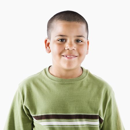 Young latino boy standing smiling at viewer. Stock Photo - 3569545
