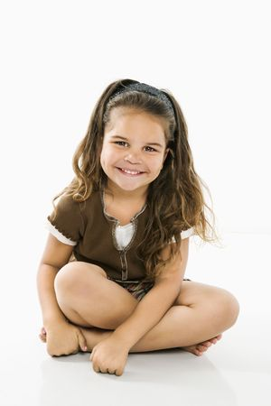 Cute little latino girl sitting looking at viewer smiling. Stock Photo - 3569499