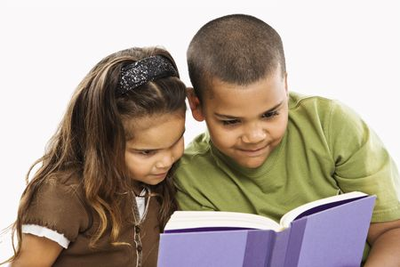 book: Boy and girl reading book together.