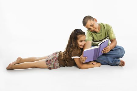 Brother and sister reading book together. Stock Photo - 3569503