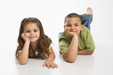 Portrait of Hispanic brother and sister lying on floor smiling at viewer. Stock Photo - 3569387
