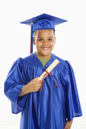 Young boy wearing blue graduation gown holding diploma. Stock Photo - 3569581