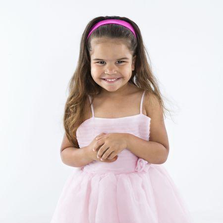 females only: Cute little hispanic girl wearing pink dress smiling.